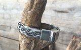 Armband 8 strengen gevlochten. Prijs €39,95/€45,00_